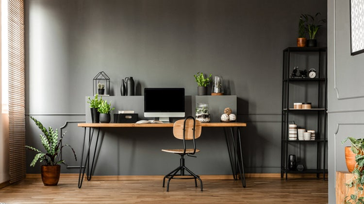 Clean office space with desktop & dark walls