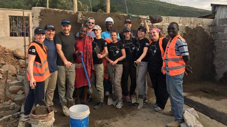 O2E team building a school during Kenya Me to We event