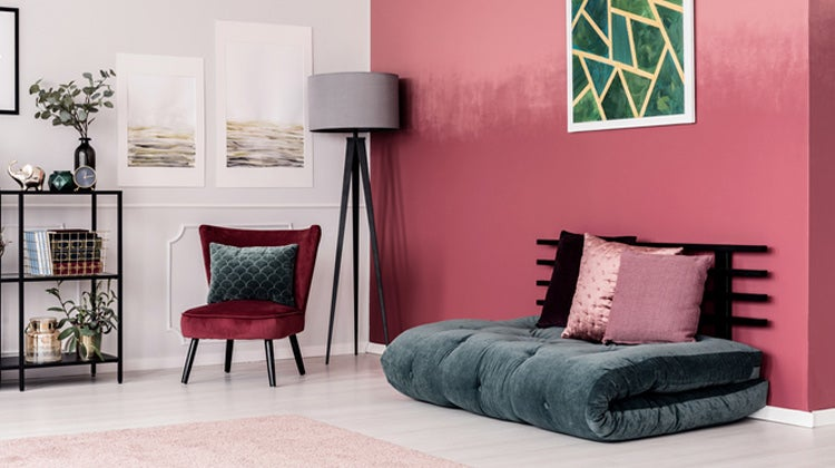 Living room with red walls & floor cushion