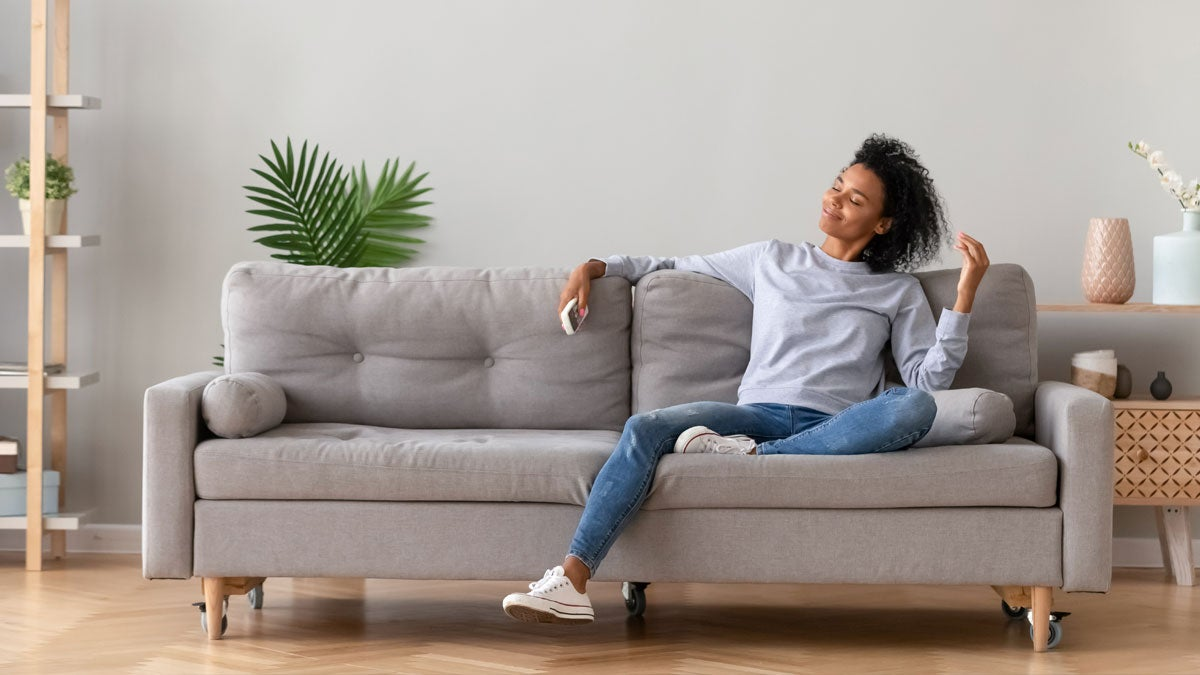 Happy women sitting on a clean couch