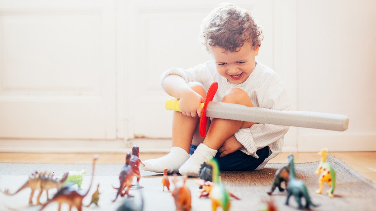 Toddler at home playing with toys