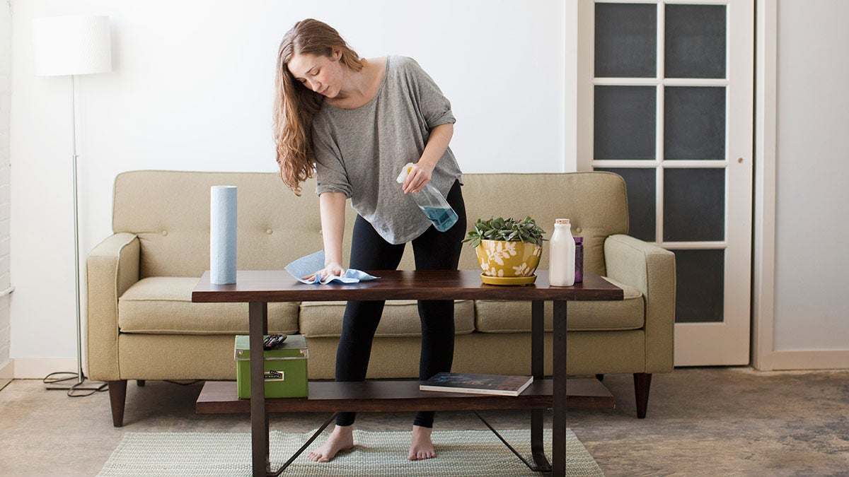 Woman cleaning a coffee table