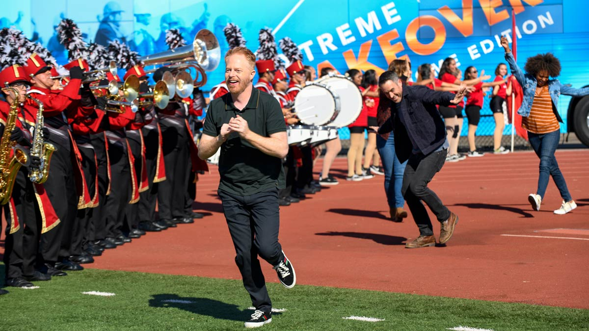 Extreme Makeover: Home Edition host in front of a trumpet band