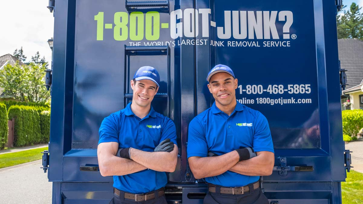 Uniformed TOMs posing in front of 1-800-GOT-JUNK? truck