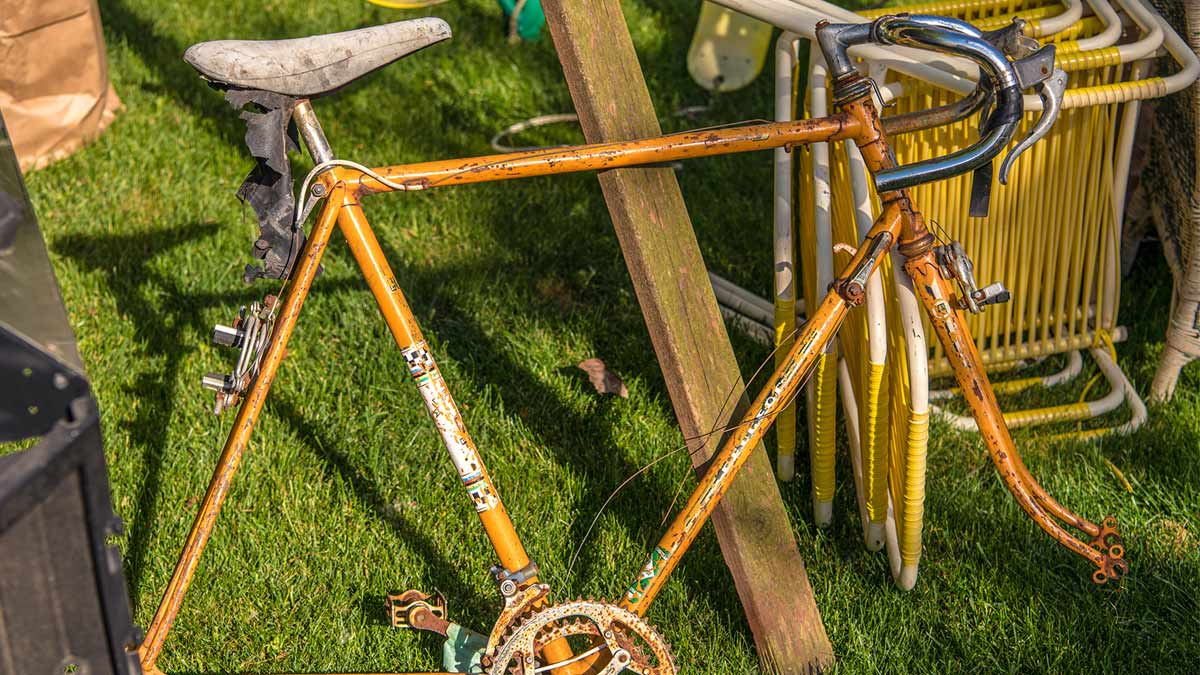 Old broken brown bicycle