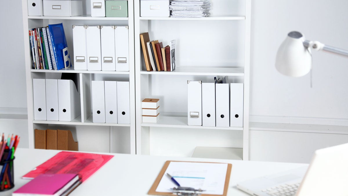 Home office space with white shelf and table