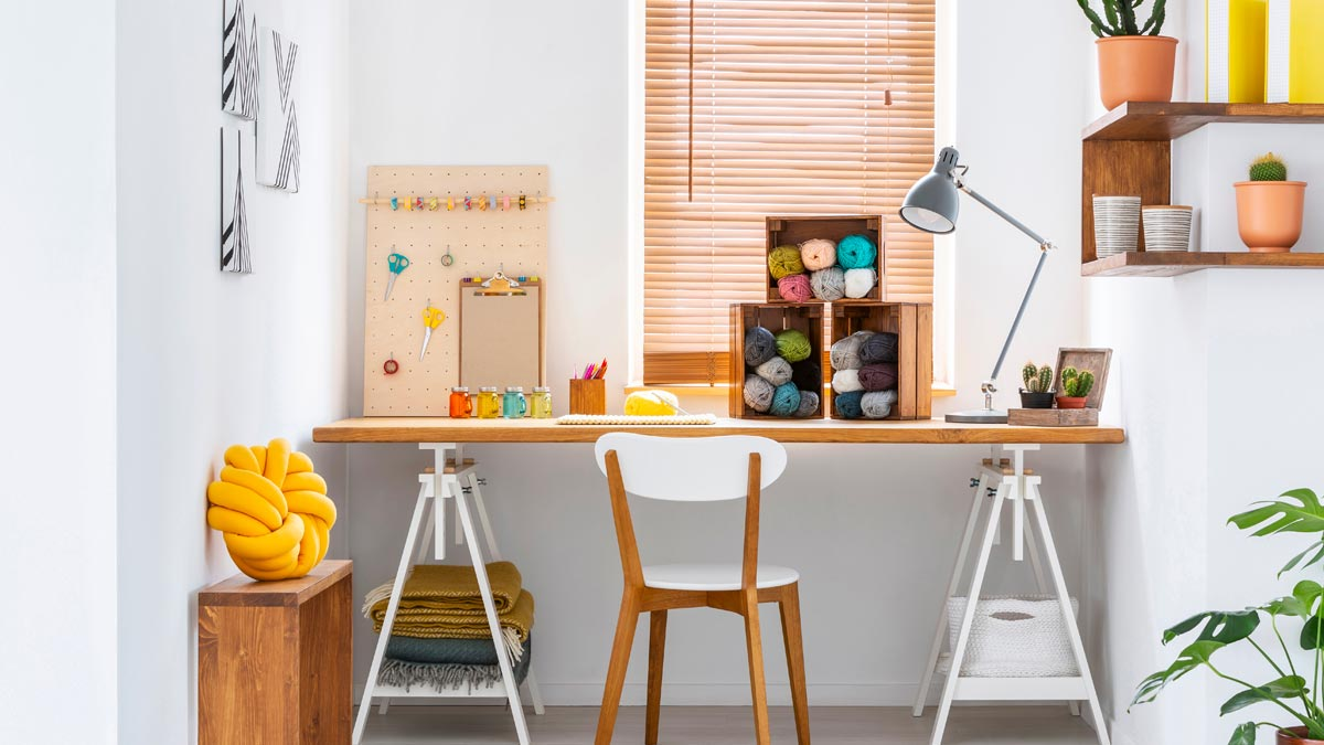 Organized desk space with table and chair