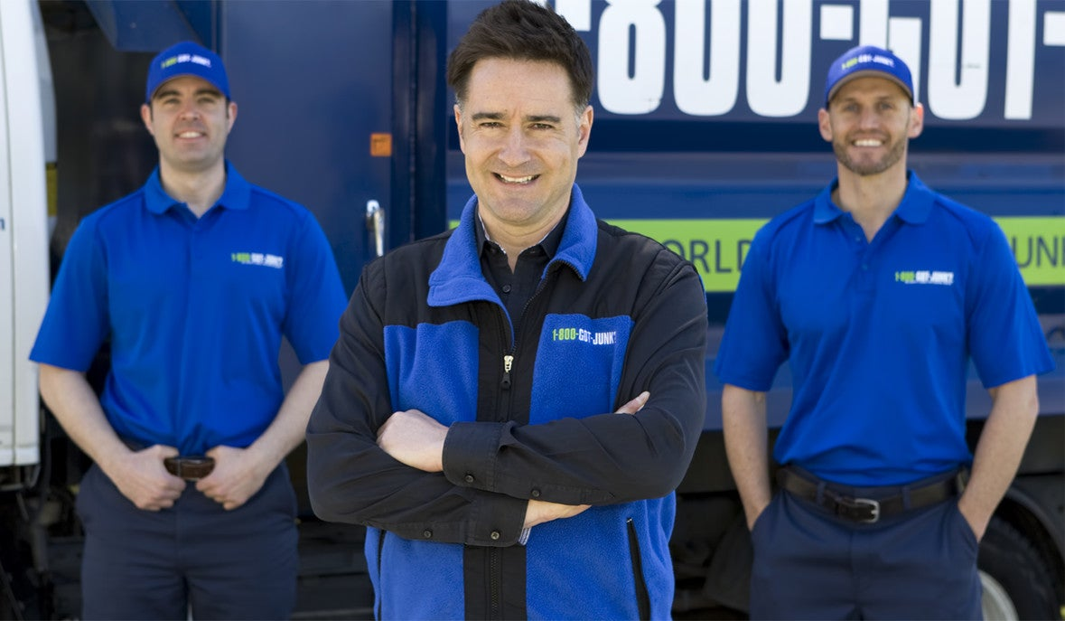 Brian Scudamore in front of 1-800-GOT-JUNK? truck