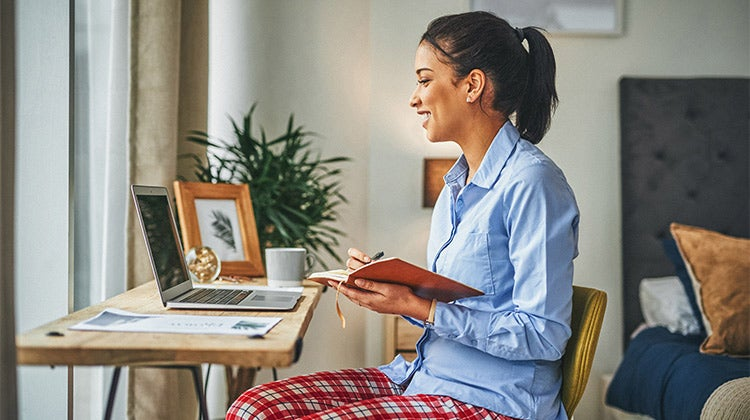 Woman working from home wearing pajama pants