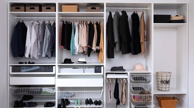 Organized closet with white shelving