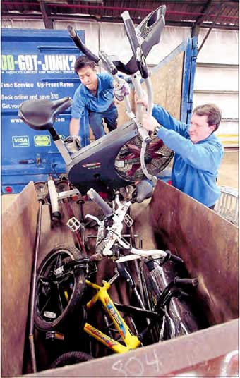 1800gotjunk loads bikes for recycling