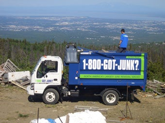 Anchorage's 1-800-GOT-JUNK? junk removal team on a job