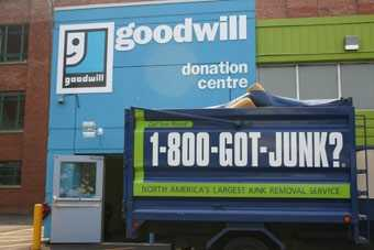 Calgary's 1-800-GOT-JUNK? team donates to Goodwill