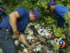 1-800-GOT-JUNK? teams hard at work removing 10 truck loads of junk from a man's property