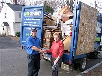Boston North's 1-800-GOT-JUNK? team removes junk from their house cleanup winner in Winchester, MA