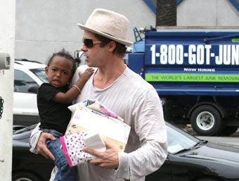 Brad Pitt in front of a Los Angeles 1-800-GOT-JUNK? truck