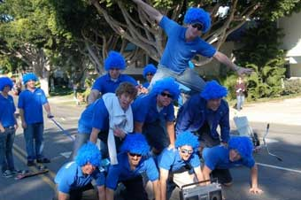 1-800-GOT-JUNK? junk removers in Huntington Beach doing a human pyramid