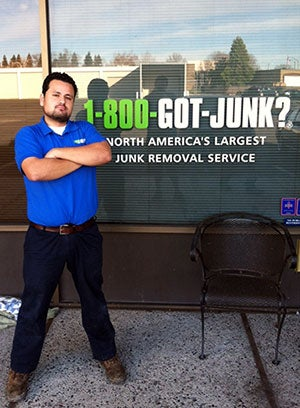One of 1-800-GOT-JUNK?'s  truck team members standing outside of our West Sacramento Office