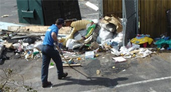 Miami's 1-800-GOT-JUNK? team removing trash