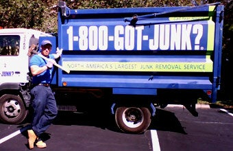 Naples junk remover stands beside a 1-800-GOT-JUNK? truck