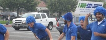 OC's 1-800-GOT-JUNK? team doing one of their crazy blue wig waves in Costa Mesa
