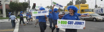 OC's 1-800-GOT-JUNK? junk removal team marketing to cars driving by