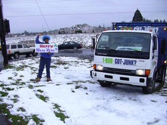 Portland's 1-800-GOT-JUNK? team participates in the Linn Holiday Parade