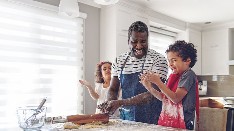 Family baking together in a clean kitchen