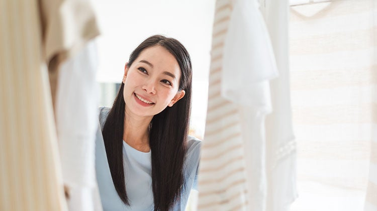 Woman looking into an organized closet