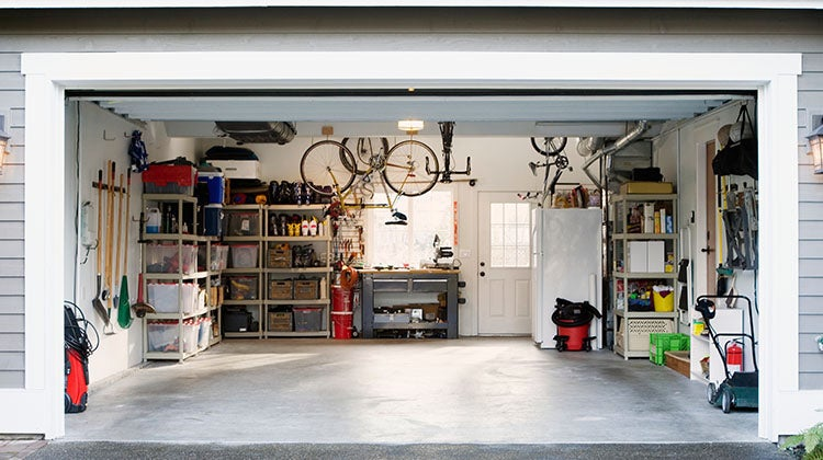 Organized garage with similar items grouped together