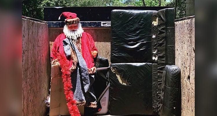large Santa statue inside a 1-800-GOT-JUNK? truck
