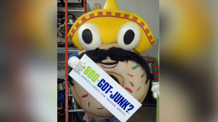 Donut mascot with a sombrero and mustache