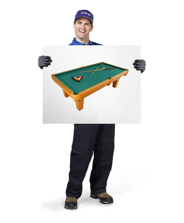 1-800-GOT-JUNK TOM ready to remove your old or broken pool table